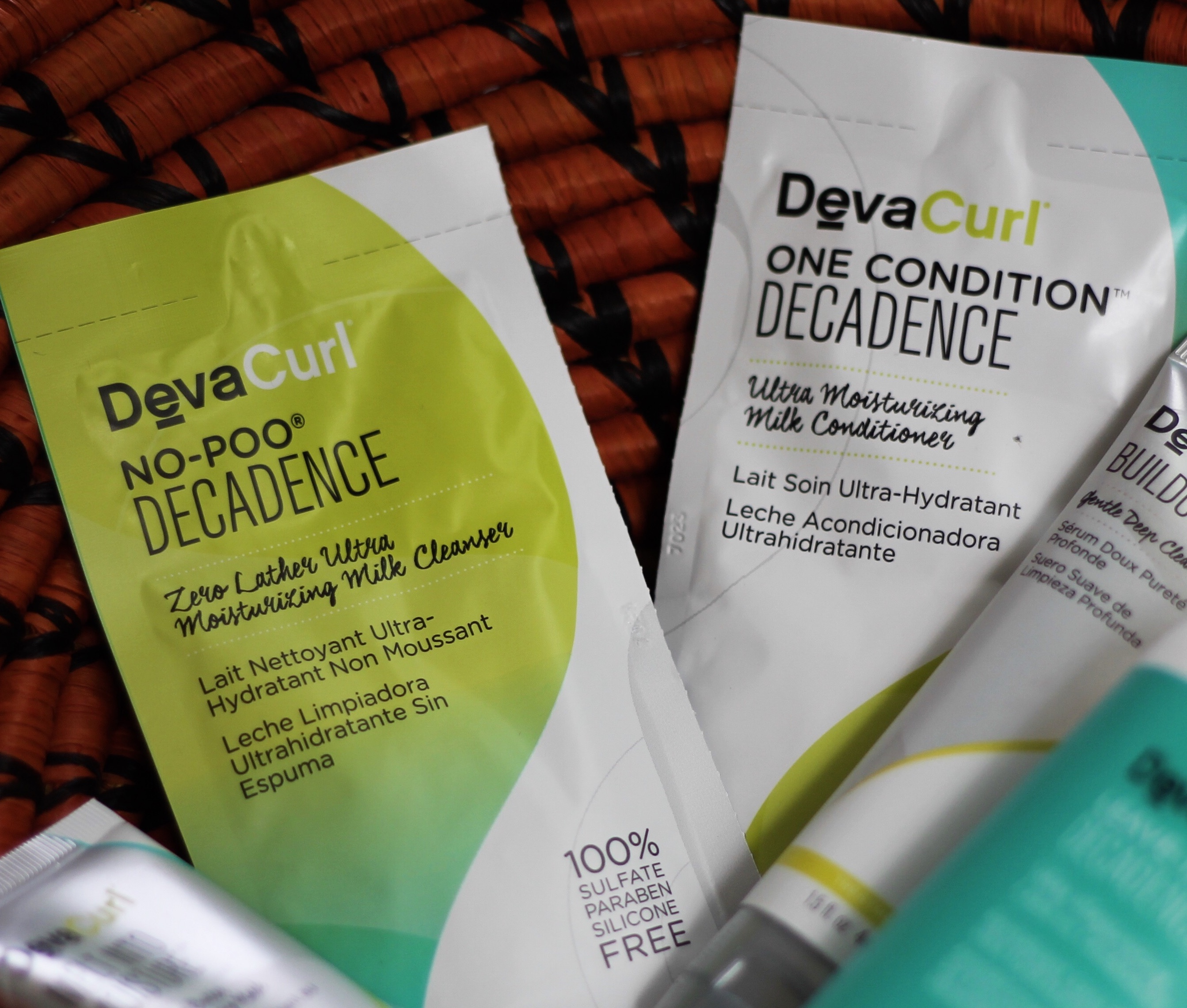 black kinky Coily hair blog, ugandan blogger, DEVACURL No-Poo® Decadence DEVACURL Buildup Buster™ Micellar Water Cleansing Serum DEVACURL Melt into Moisture Matcha Butter Conditioning Mask DEVACURL One Condition™ Decadence DEVACURL Leave-In Decadence™ Ultra Moisturizing Leave-In Conditioner